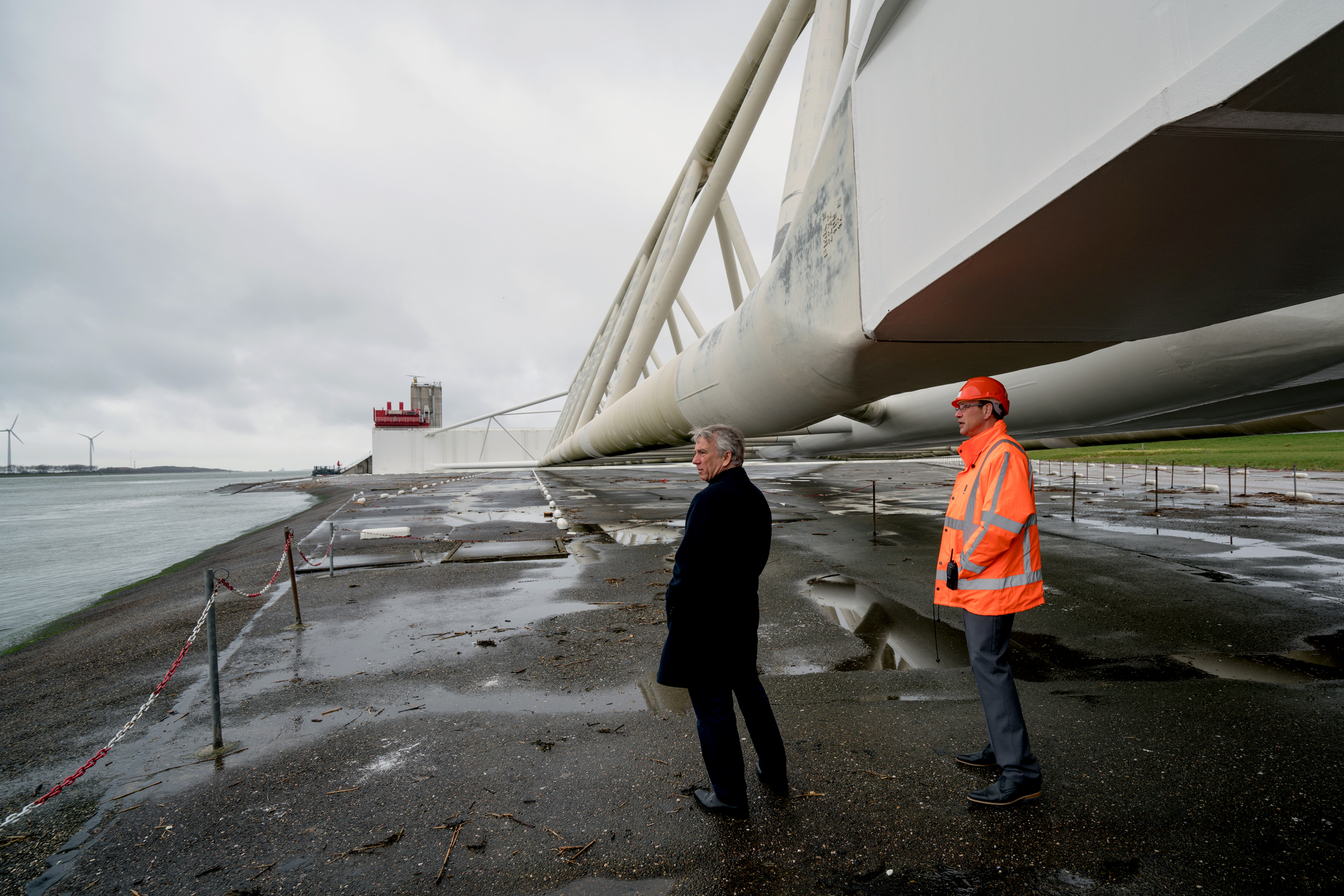 Piet Dircke (left) looks across the Nieuwe Waterweg from beneath one of the giant arms of the Maeslantkering storm surge barrier.
