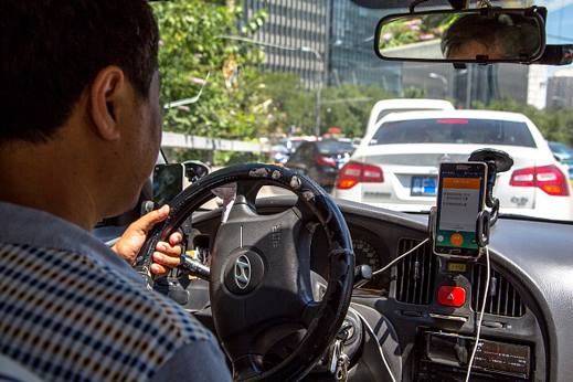 In China, drivers for local firm Didi Kuaidi and Uber both compete with traditional taxi drivers.