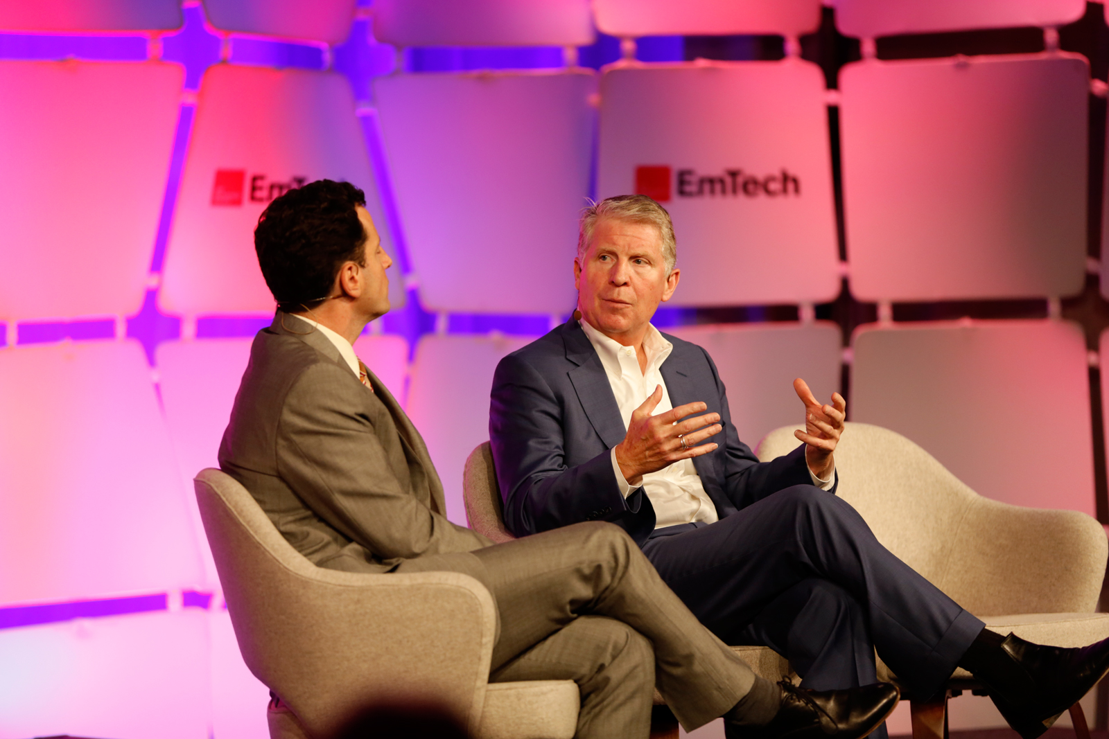Brian Bergstein and Cyrus Vance Jr. on stage at EmTech MIT 2016.