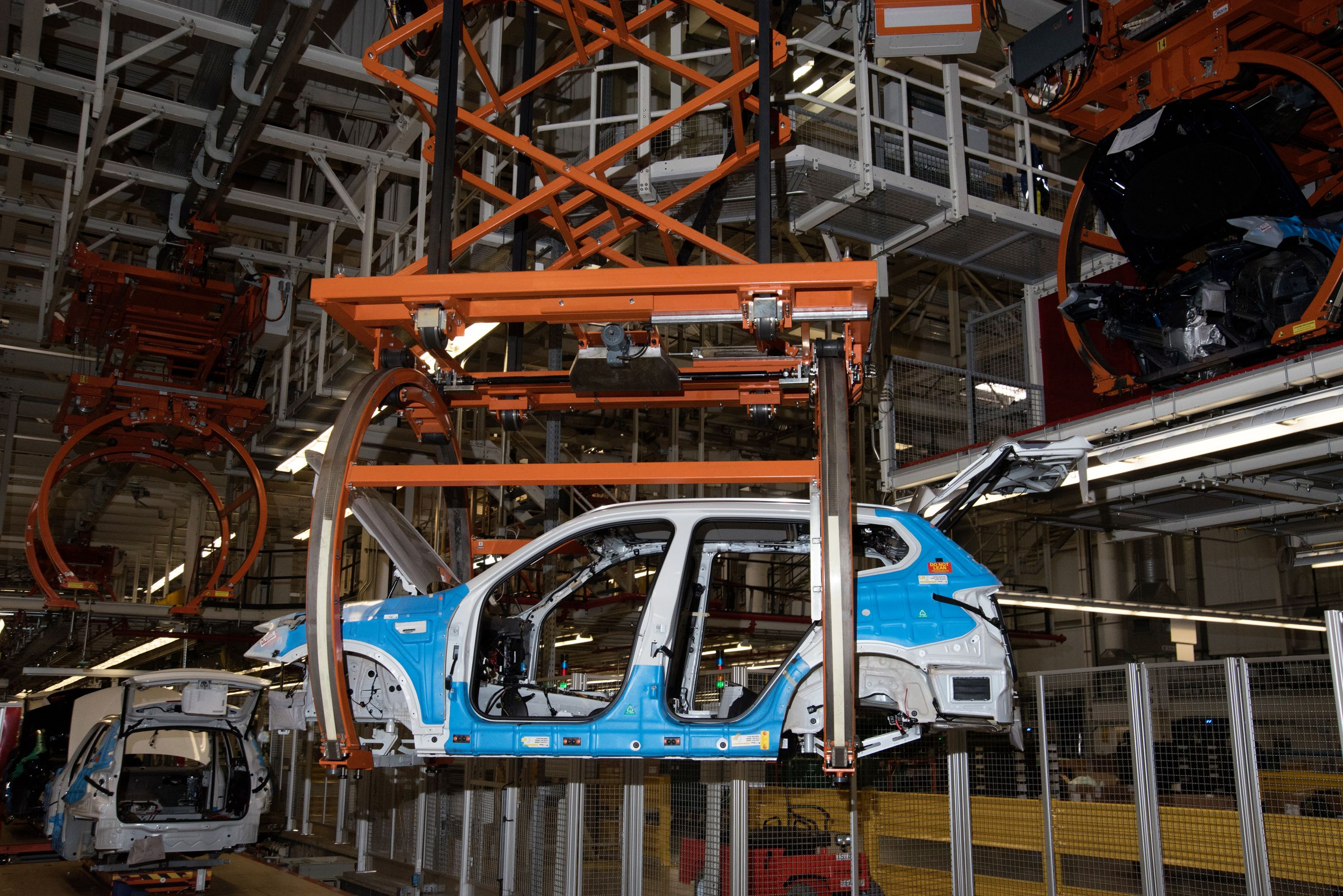 Cars are transported along the assembly line on a conveyor system. (7 of 7)