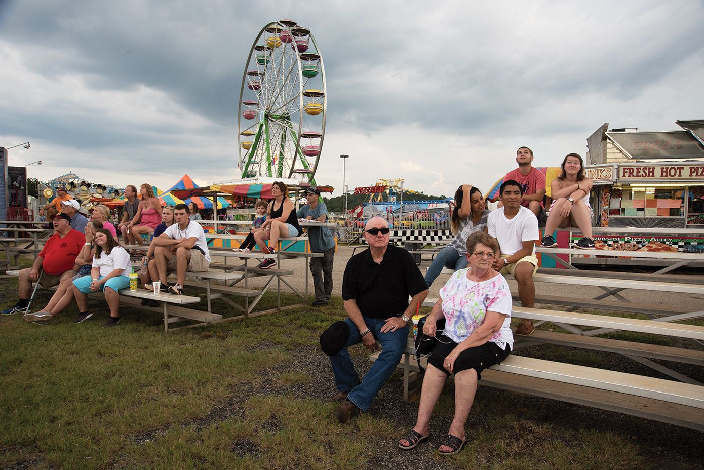 A family enjoys the Upper South Carolina State Fair at the NASCAR Greenville Pickens ­Speedway.
