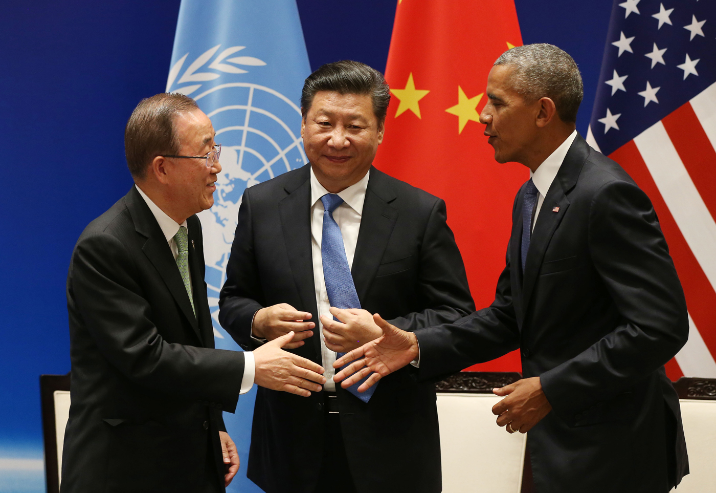 U.N. Secretary General Ban Ki-moon, Chinese President Xi Jinping, and U.S. President Barack Obama shake hands after China and the U.S. signed on to the Paris climate agreement in September 2016.