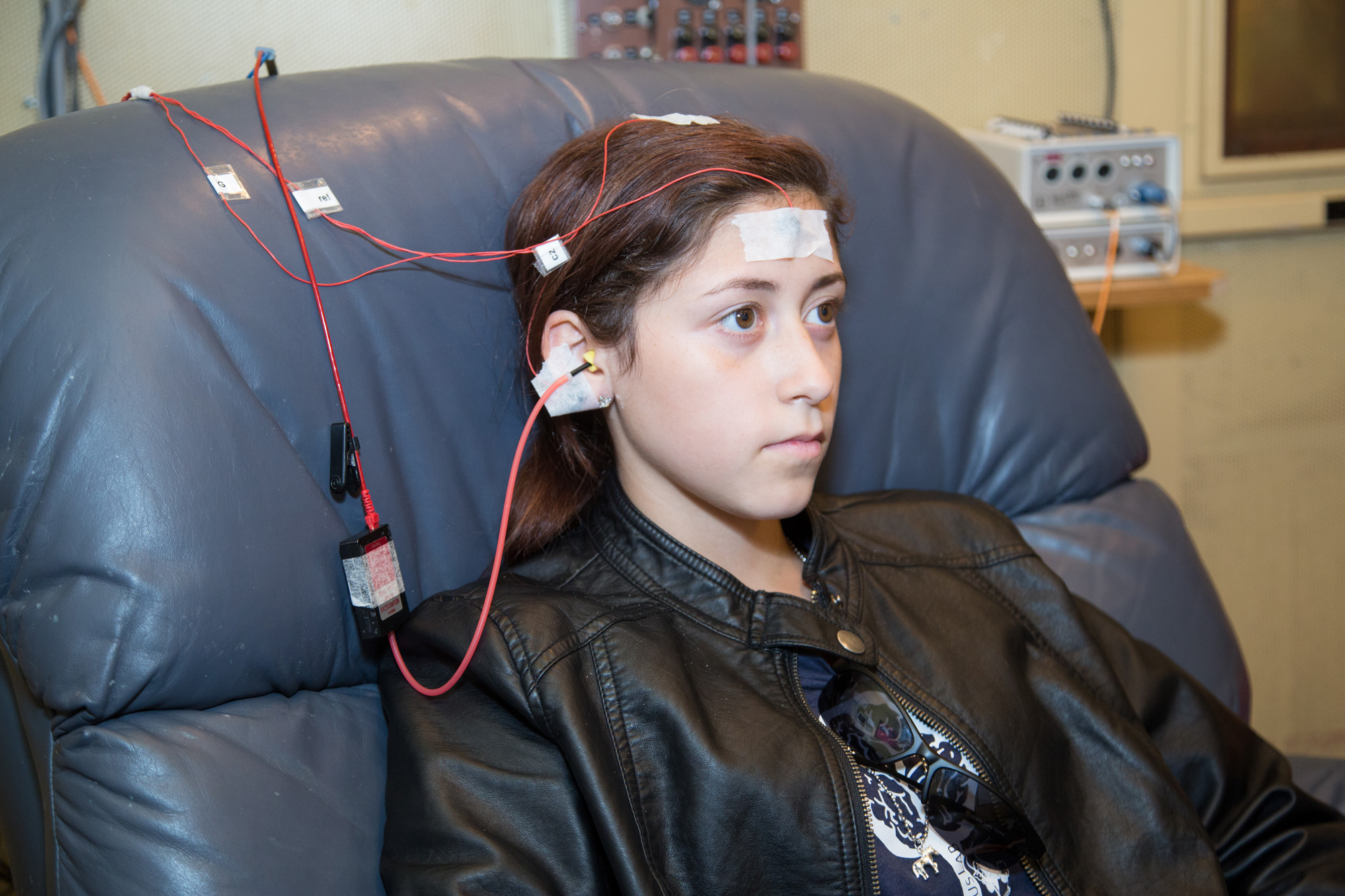 In a study at Northwestern University, a boy listens to a series of sounds while electrodes measure his brain activity to help diagnose a concussion.