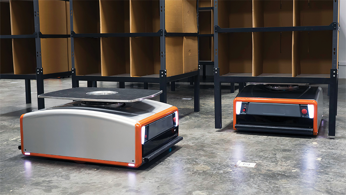 Two of GreyOrange's Butler robots, which are designed to be warehouse workhorses.