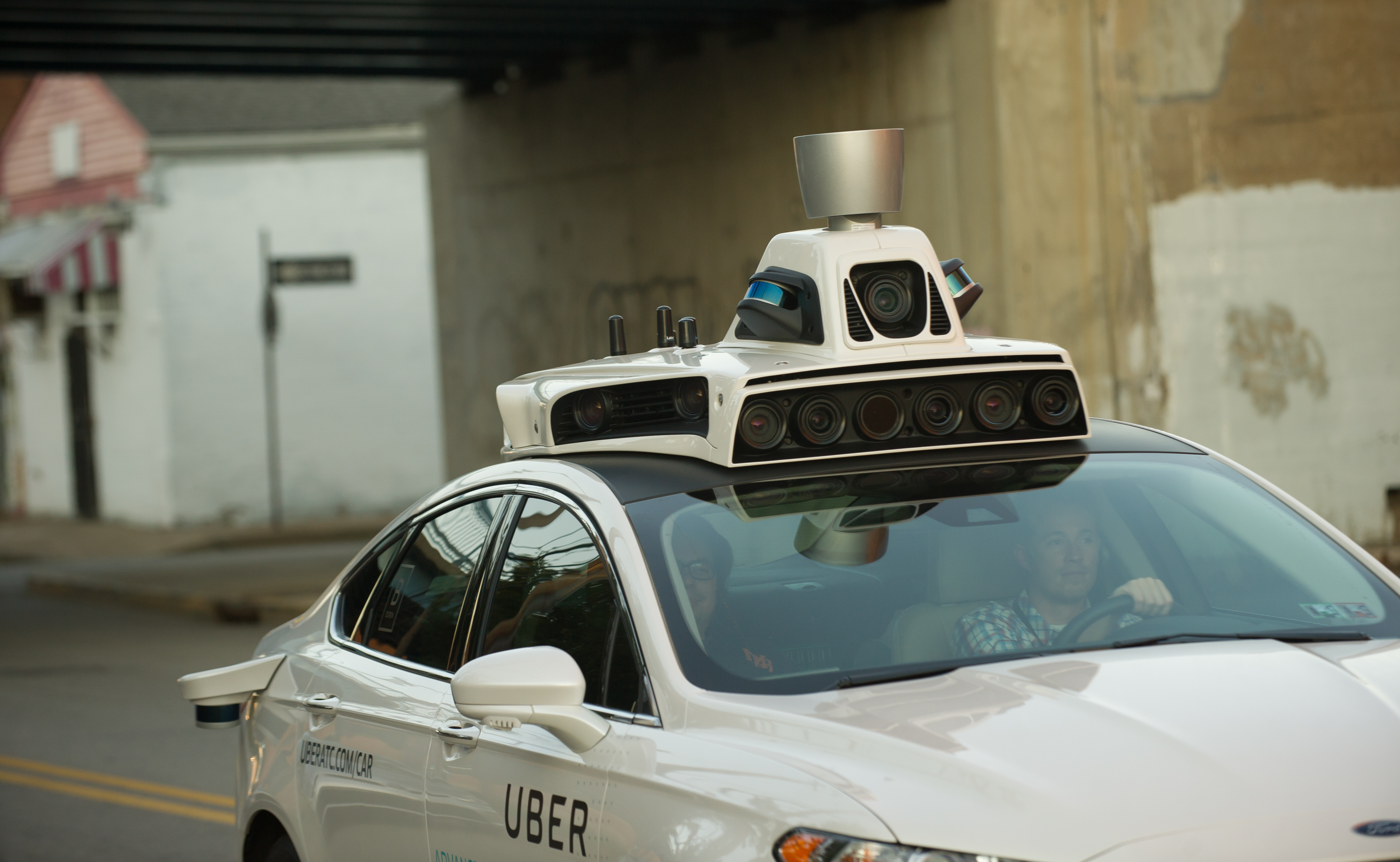 One of Uber's autonomous Ford Fusion cars in Pittsburgh, Pennsylvania. With a driver.