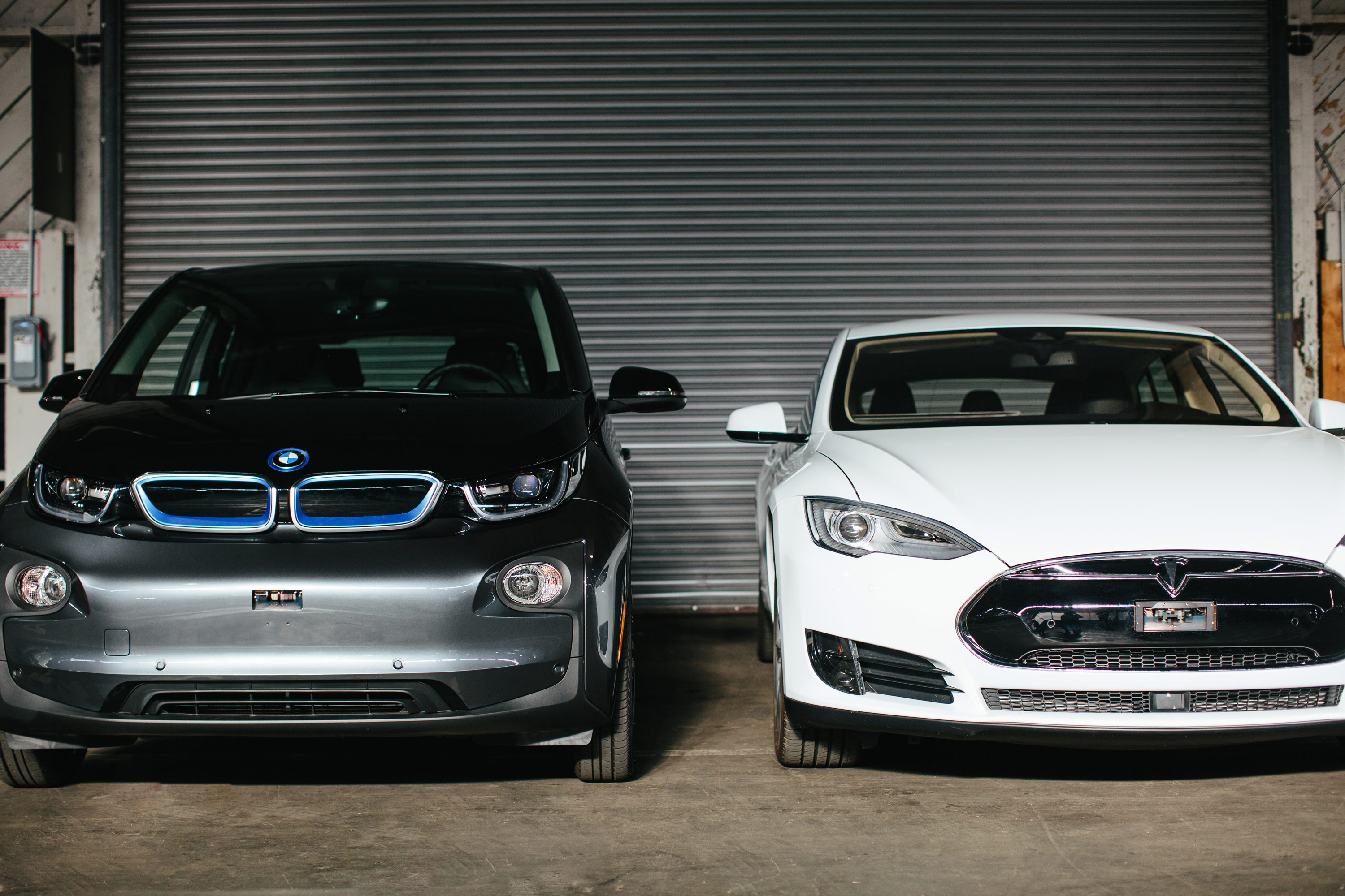 Luminar sensors integrated into the fenders of BMW and Tesla vehicles.
