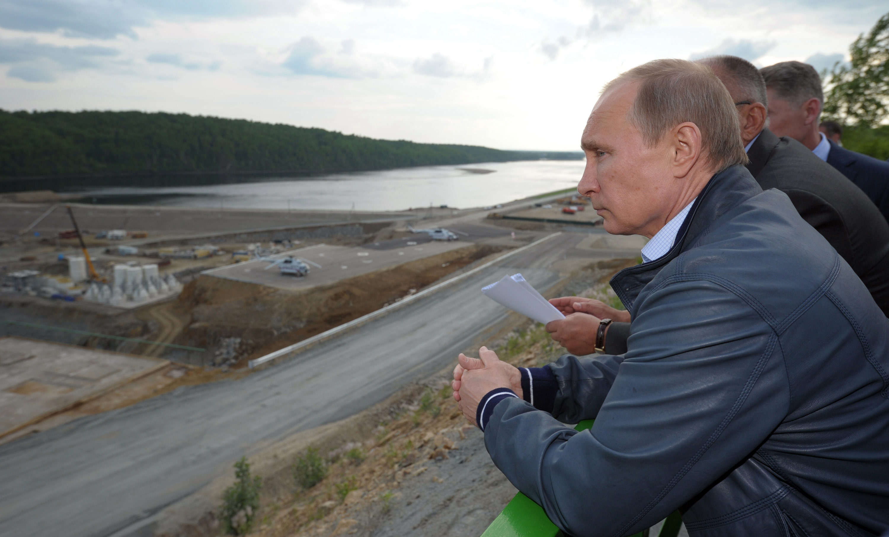Russian president Vladimir Putin surveys the construction of a hydroelectric facility in Eastern Russia.